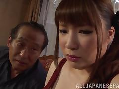 Chubby Japanese babe with long hair shows off her big tits