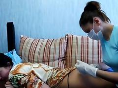 Asian ass receives an injection