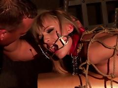 Beautiful sex slave with long blonde hair being tortured and fucked by a stranger