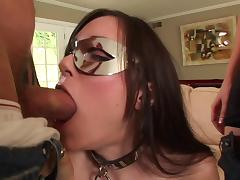 Masked brunette Sasha Grey works on two boners and enjoys a DP