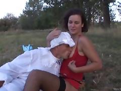Hot brunette pegging stud's ass on the grass with strapon cock