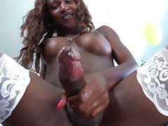 Dashing ebony shemale in enticing lingerie masturbating