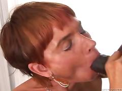 A mature white woman gets fucked and filled with cum by a black guy