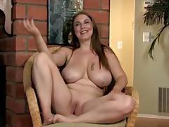 Breasty mature bimbo masturbating