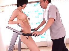 While walking on a treadmill this Asian hottie gets fucked from behind