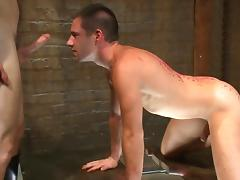 Gay couple enjoying BDSM porn