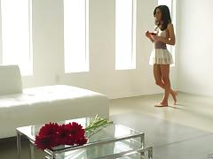 On a bed of flower petals Tia Cyrus massages her clit
