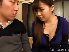 A chubby Japanese girl grinds on a guy's cock and cums