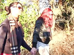 During a nature hike these two babes get naked and fuck