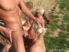 Granny sluts in the mud sucking cock and getting fucked in group sex