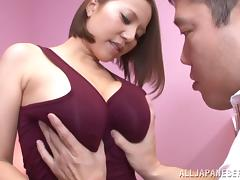 Hot Japanese babe with massive tits playing with a stranger's big cock