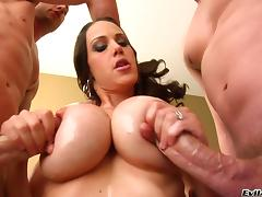 Curvy brunette with fake tits awarding her gentleman with superb titjob