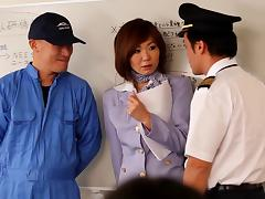 A Japanese MILF has group sex with several of her co-workers