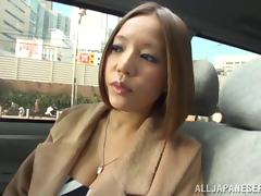 A busty Asian girl gives guys head in a porn store