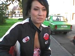 Kinky brunette with big tits licking and sucking a stranger's cock