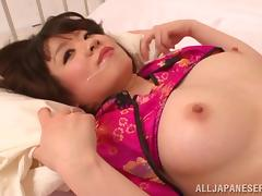 Sexy Japanese babe with a great rack molested by two horny geeks