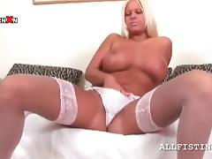 Sex bomb blonde rubs big tits and lusty cunt