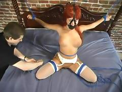 A hogtied slut gets her pussy worked with a vibrator