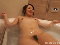 A hair Asian beauty with small tits gets fingered in the bath