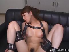 With her arms and legs in bondage she gets her hairy cunt toyed