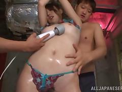 Her hairy pussy gets teased with vibrators in this hot Japanese mmf threesome
