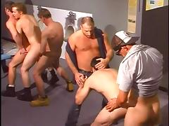 Horny trucker in gay orgy