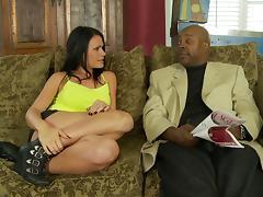 Sexy porn star with long dark hair enjoying a hardcore interracial fuck