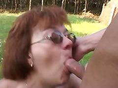 Young farm boy fucking an aged granny outdoors