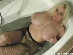 Mayaa takes her fishnet pantyhose off to play with her big natural tits