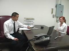 Tattooed redhead sucking her employer's cock in his office