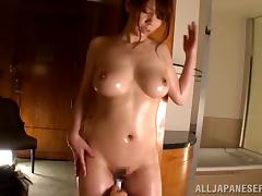 A curvy oiled up Asian babe gets her nipples and clit vibrated