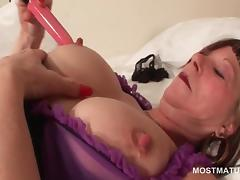 Turned on mature slut sucks dildo and rubs her muffin