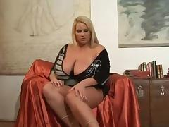 BBW Laura pulls out her massive melons while flashing her shaved pussy