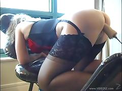 Lingerie-clad cougar with a nice ass enjoying a hardcore dildo machine fuck