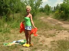 A teen babe from Holland fingers herself in the great outdoors