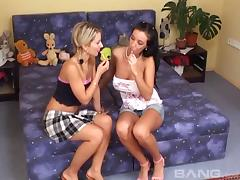 Cute college girls experimenting with toys in their bedroom