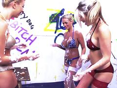 Bikini girls rub dessert into each other and make a hot mess