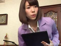 Japanese business chick gives the sexiest foot job