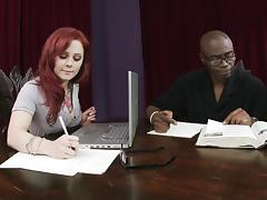 Interracial co-workers get busy on the board room table