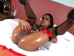 Hung shemale Michelle Z lays back and strokes her cock