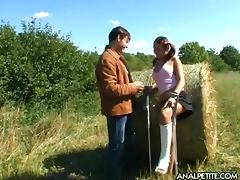 Farm boy and a cute girl fuck passionately in a field of hay