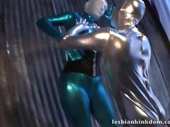 Lesbians with latex fetish in bodysuits stripping and fucking