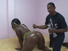 Curvy ebony pornstar gets her black butt oiled before being banged hardcore