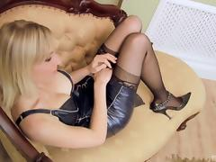 Two blondes in leather outfits play around with dildos