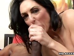 Mature brunette pornstar coping with a big black cock hardcore