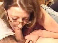 Mature slut sucks dick in a private video