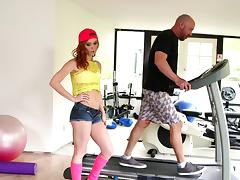 Teen redhead goes to the gym to exercise her blowjob skills