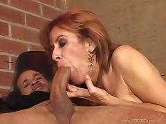 Redhead cougar gives big black cock blowjob then rimmed in interracial sex