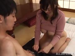 Mini-skirt clad Asian cougar with fantastic juggs playing with a stranger's cock