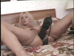 Blonde stretches her pussy with a gigantic inflated dildo